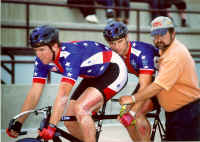 Coach Mark Tyson holding the bike for Garth and Matt at the 1998 IPC World Cycling Championships in Colorado Springs, Colorado. (Photo by Casey Gibson)
