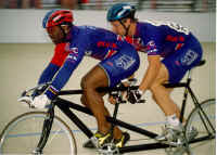 Kirk Whiteman and Matt competing in the men's match sprints at the 2000 Paralympic Track Cycling Trials in Frisco, Texas. (Photo by Casey Gibson)